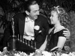 Walt-Disney-Getting-Oscar-for-Snow-White-and-the-Seven-Dwarfs