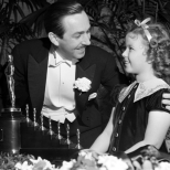 Walt-Disney-Getting-Oscar-for-Snow-White-and-the-Seven-Dwarfs